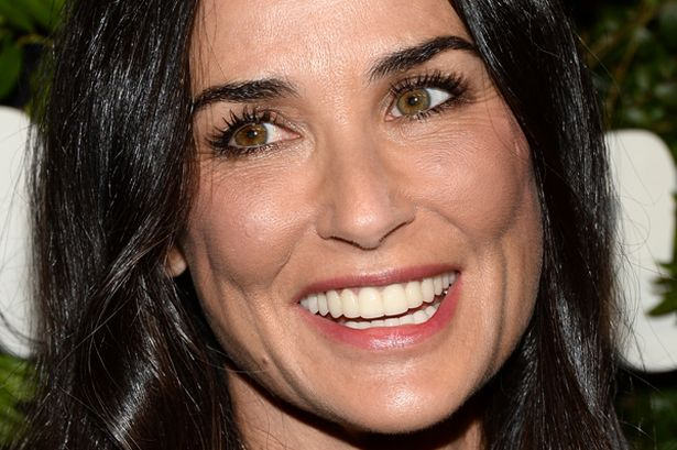 Actress-Demi-Moore-arrives-at-the-Salvatore-Ferragamo-100-Years-In-Hollywood