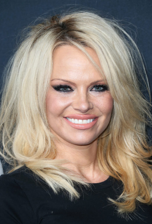 LOS ANGELES, CA - FEBRUARY 10: Actress Pamela Anderson arrives at the Saint Laurent show at The Hollywood Palladium on February 10, 2016 in Los Angeles, California. (Photo by Frederick M. Brown/Getty Images)