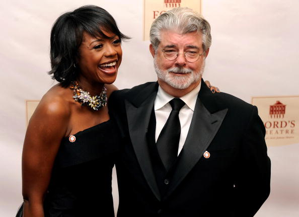 Filmmaker George Lucas (R) arrives at newly-renovated Ford's Theatre with Mellody Hobson, president of Ariel Investments, for a gala to mark the 200th anniversary of the birth of US President Abraham Lincoln, February 11, 2009, in Washington, DC. Lucas will receive the Lincoln Medal Award for his accomplishments which exemplify the character and legacy of Lincoln, who was assassinated at the Theatre in 1865. AFP PHOTO/MIKE THEILER (Photo credit should read MIKE THEILER/AFP/Getty Images)