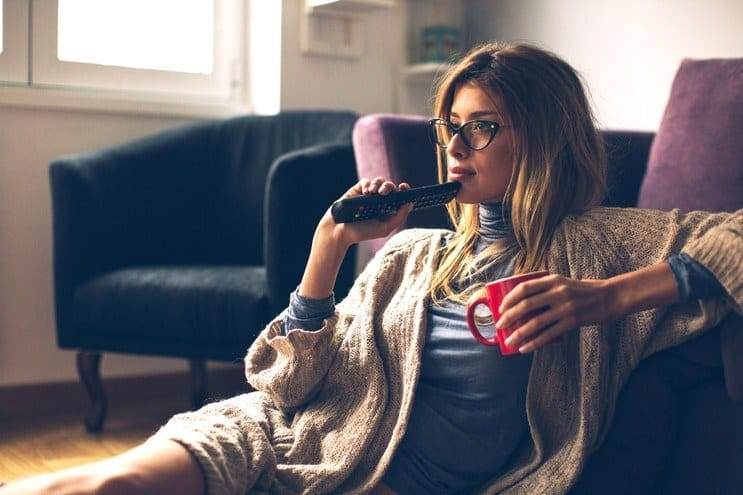 home-2016-02-girl-with-glasses-watching-tv-main