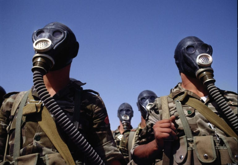 SAUDI ARABIA - MARCH 1990: Syrian troops photographed during a gas mask training exercise during the run up to the first Gulf War. (Photo by Tom Stoddart/Getty Images)