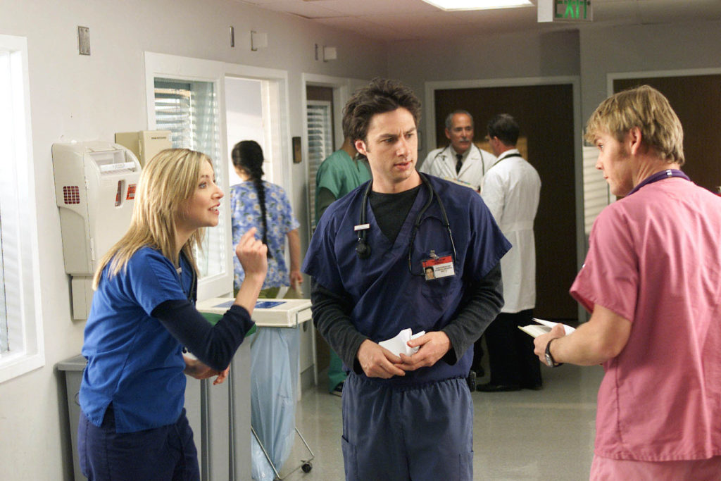 "SCRUBS -- NBC Series -- ""My TCW"" -- Pictured: (l-r) Sarah Chalke as Elliot Reid, Zach Braff as John ""J.D."" Dorian, Rick Schroder as Paul -- NBC Photo: Paul Drinkwater"