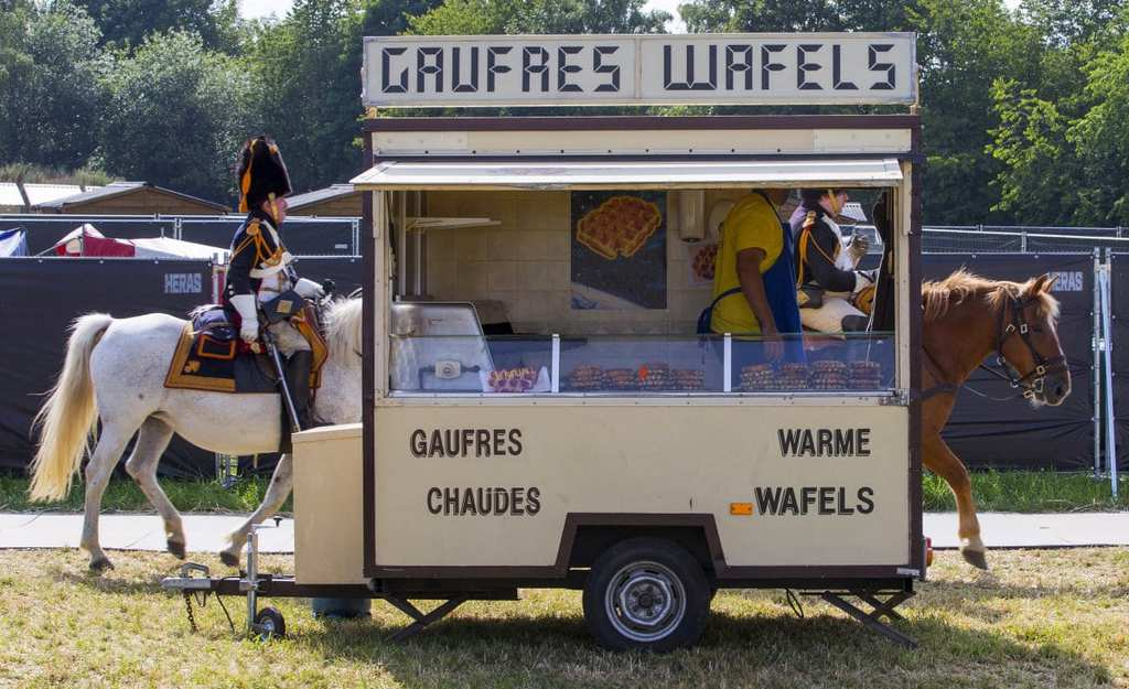 we-wish-this-half-horse-half-waffle-truck-was-real-its-actually-just-a-well-timed-shot-as-two-horses-pass-behind-a-truck-during-celebrations-for-the-battle-of-waterloo-in-belgium-on-june-18-2015