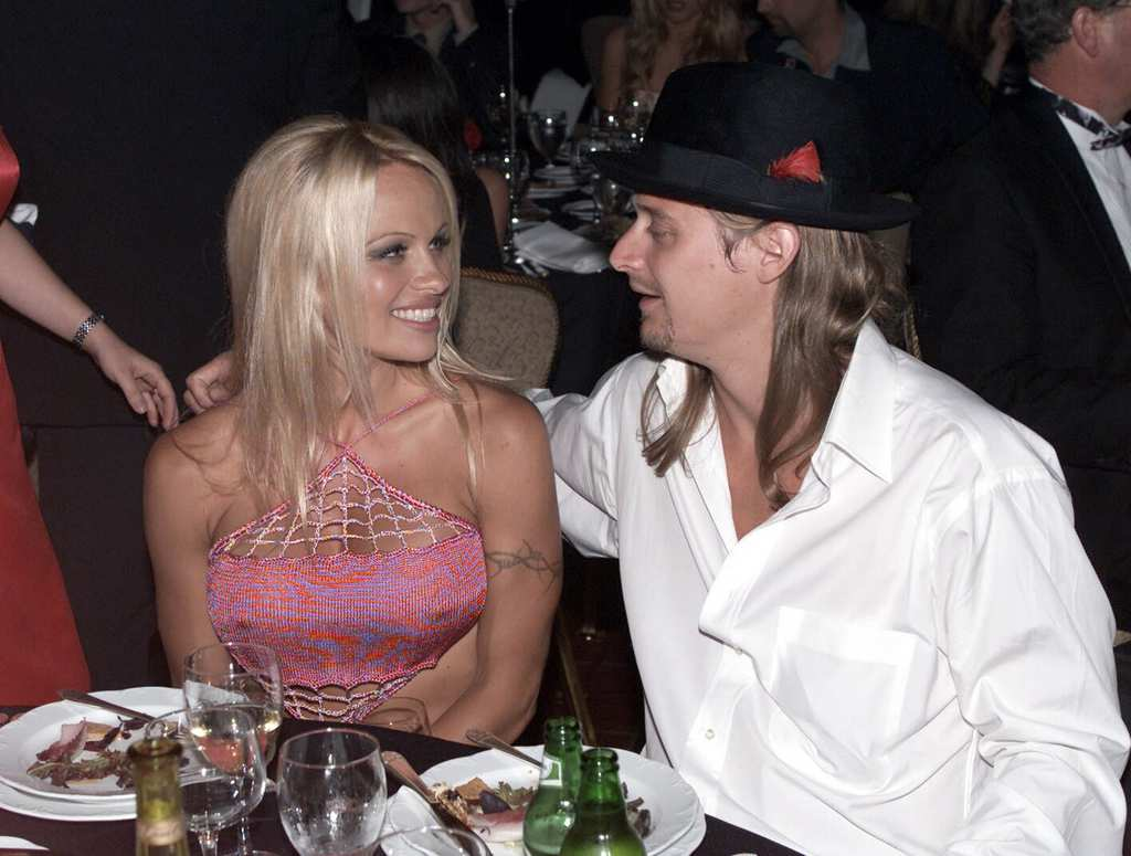 "NEW YORK - SEPTEMBER 9: American actress Pamela Anderson and her boyfriend American pop star ""Kid Rock"" attend the 21st Anniversary for PETA at the Waldorf Astoria Hotel on September 9, 2001 in New York. (Photo by Dave Hogan/Getty Images)"