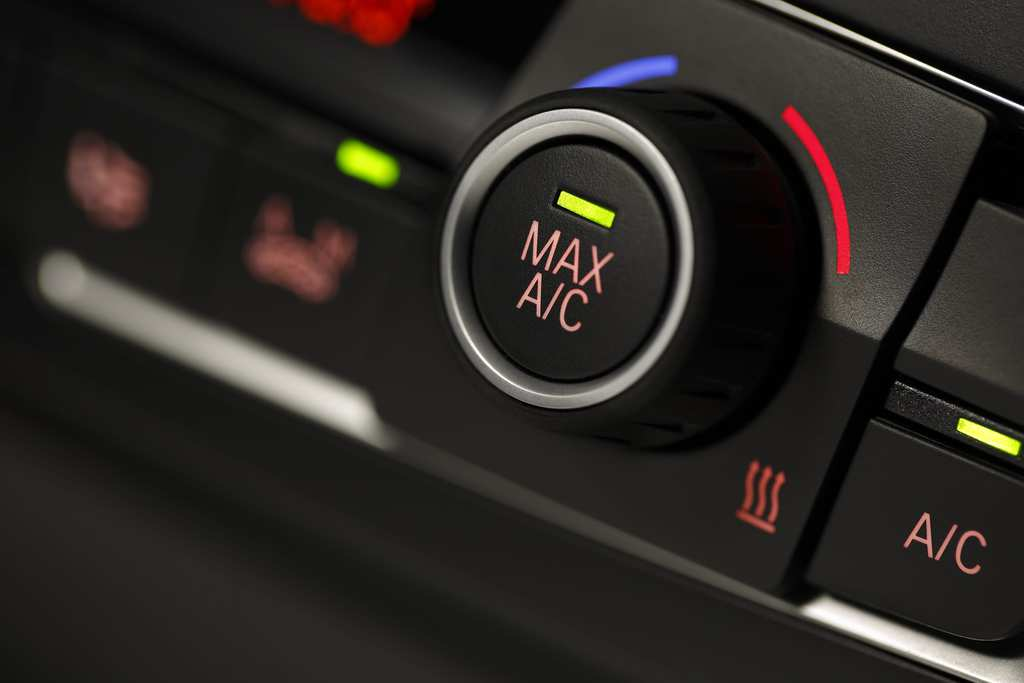 Color detail with the air conditioning button inside a car, shot with very shallow depth of field , Macro photography