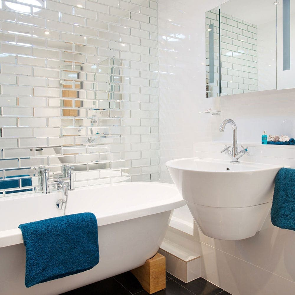 Easy decorating tricks to make your tiny bathroom look for Small bathroom big or small tiles