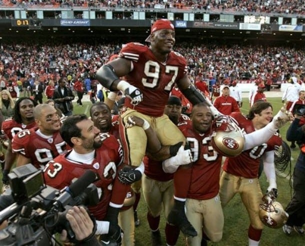 San Francisco 49ers defensive end Bryant Young (97) is carried off the field by teammates after his team's win over the Tampa Bay Buccaneers in an NFL football game in San Francisco, Sunday, Dec. 23, 2007. San Francisco won 21-19. Young plans to retire at the end of the season. (AP Photo/Marcio Jose Sanchez)