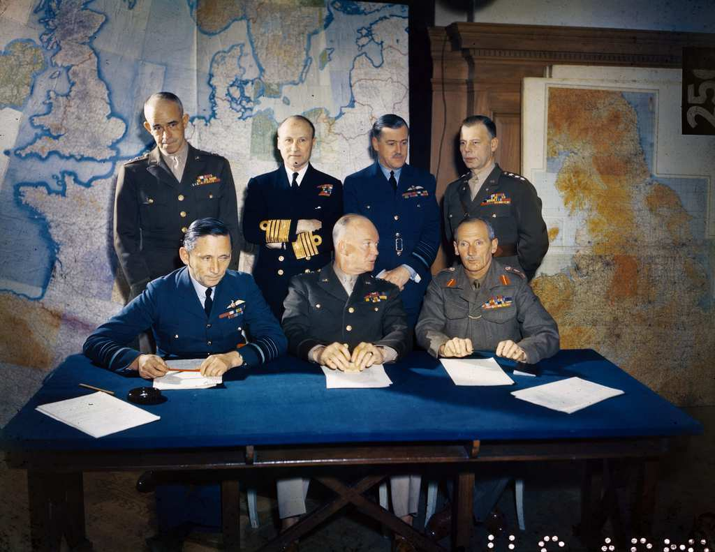 ca. 1944 --- General Dwight D. Eisenhower is shown with his staff. Left to right, seated: Air Chief Marshall Sir Arthur Tedder, General Eisenhower and General Sir Bernard Montgomery. Left to right, standing: Lieutenant General Omar Bradley, Admiral Sir Bertram Ramsey, Air Chief Marshal Sir Trafford Leigh Mallory and Lieutenant General W. Bedell Smith. --- Image by © Bettmann/CORBIS