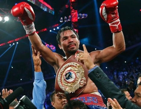 Manny Pacquiao, from the Philippines wears the champion's belt after winning Brandon Rios of the United States in their WBO world welterweight fight Sunday, Nov. 24, 2013, in Macau. (AP Photo/ Vincent Yu)