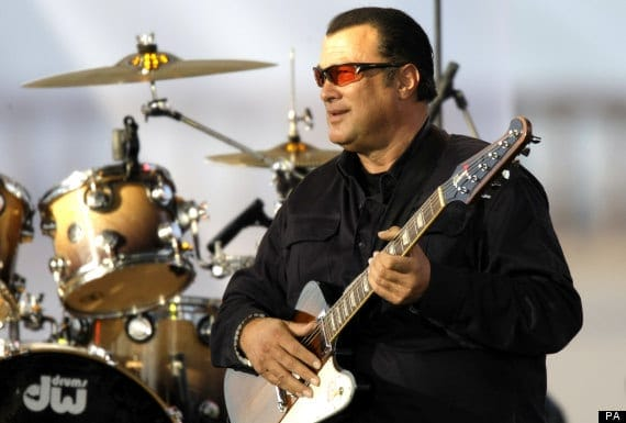 American actor Steven Seagal plays in a charity concert organized by the Federation charity in Moscow, Russia, Sunday, July 10, 2011. Federation held a charity ball last year with Prime Minister Vladimir Putin performing on the piano. (AP Photo/Misha Japaridze)