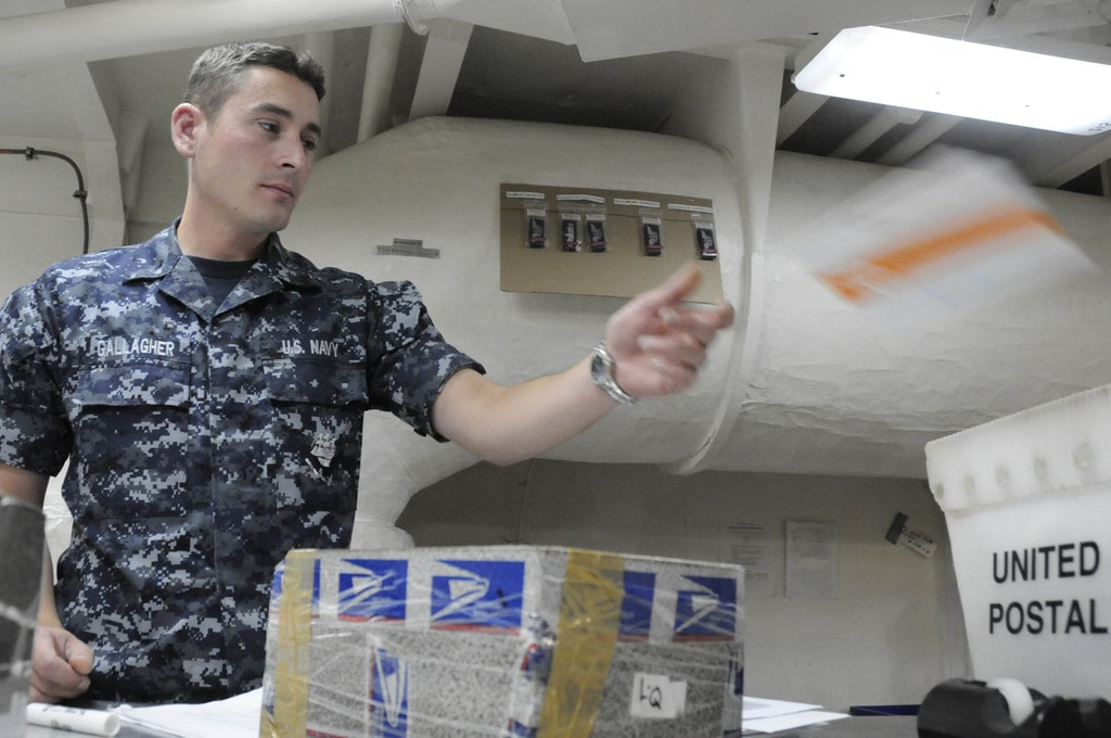 US_Navy_100709-N-2918M-049_Logistics_Specialist_Seaman_Noel_Gallager_sorts_mail_in_the_post_office_aboard_USS_Nimitz_%28CVN_68%29