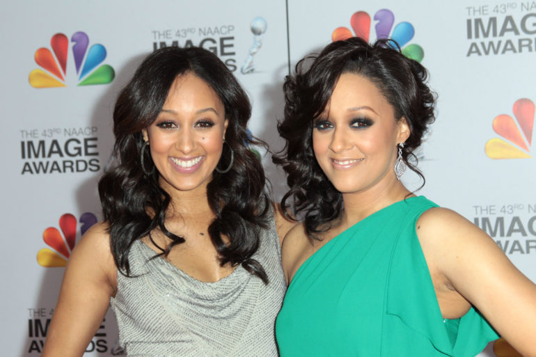 LOS ANGELES, CA - FEBRUARY 17: Actresses Tamera Mowry-Housley (L) and Tia Mowry arrive at the 43rd NAACP Image Awards held at The Shrine Auditorium on February 17, 2012 in Los Angeles, California. (Photo by Frederick M. Brown/Getty Images for NAACP Image Awards)