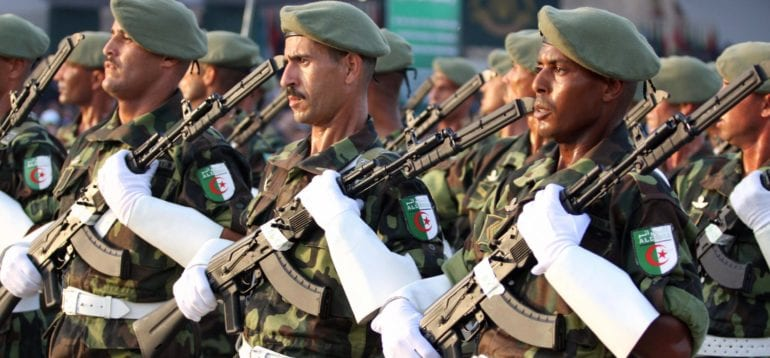 Algerian troops march during a military