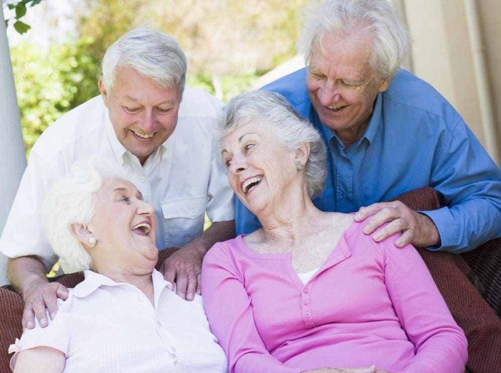 four-older-people-laughing