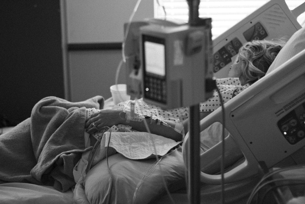 06-woman-on-hospital-bed-1024x683